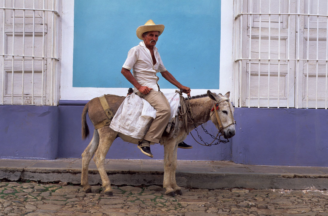 Trinidad Man riding a donkey