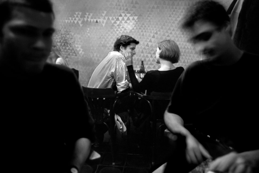 Couple embrace in Czech Republic Cafe