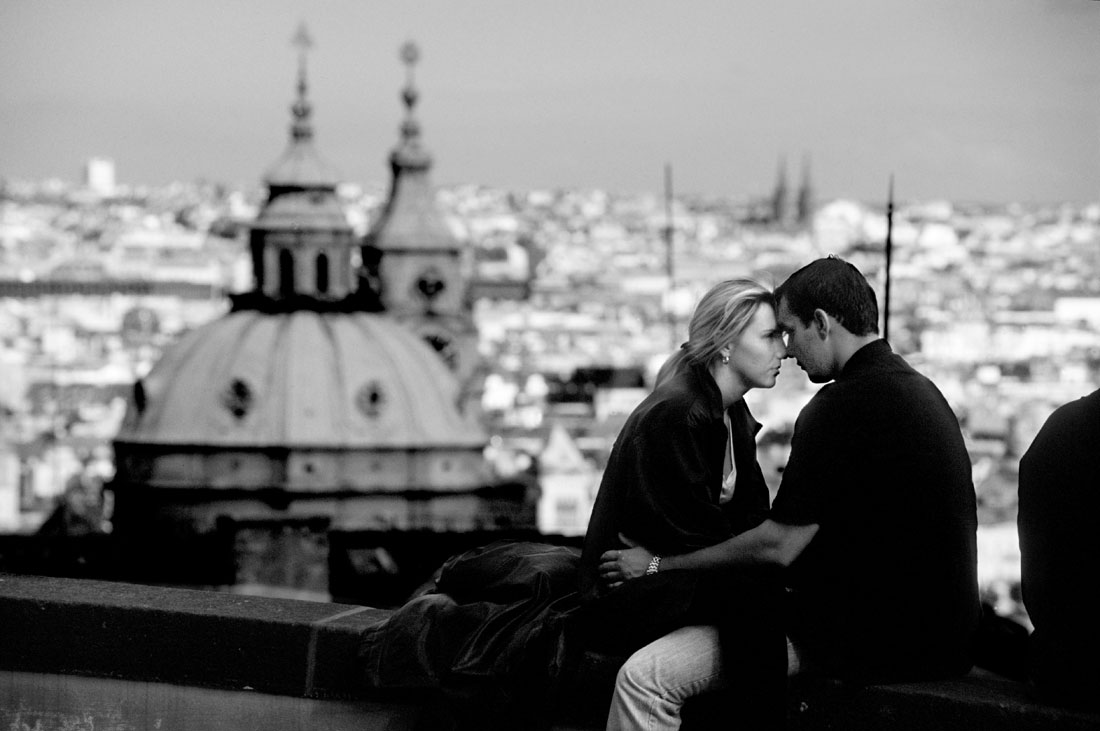 Couple embracing at an overlook of the city of Prague