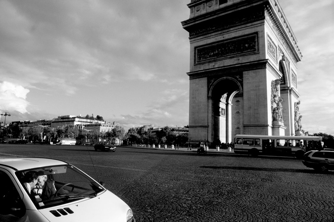 Couple kissing in car at Arc de Triomphe in Paris France