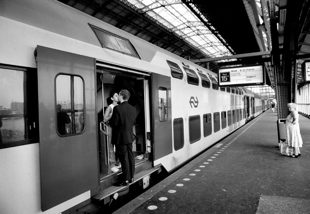 Couple kissing on Amsterdam Train